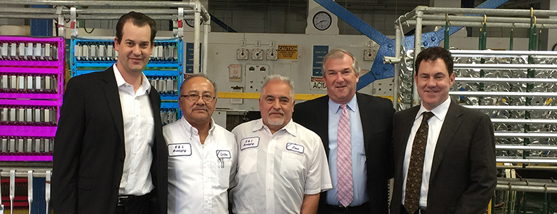 Jose Toscano stands with other representatives of K&L and the greater plating industry